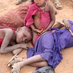Thirsty Masai Children laying down and resting